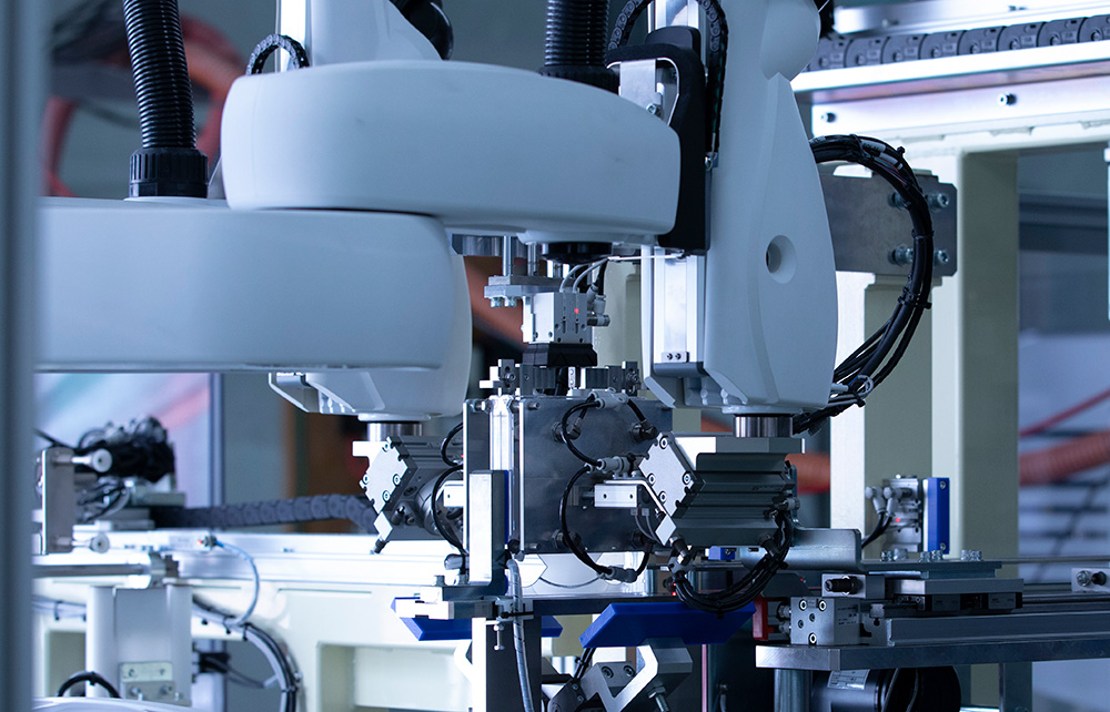 マルチケース組立自動機械(双腕ロボット仕様)